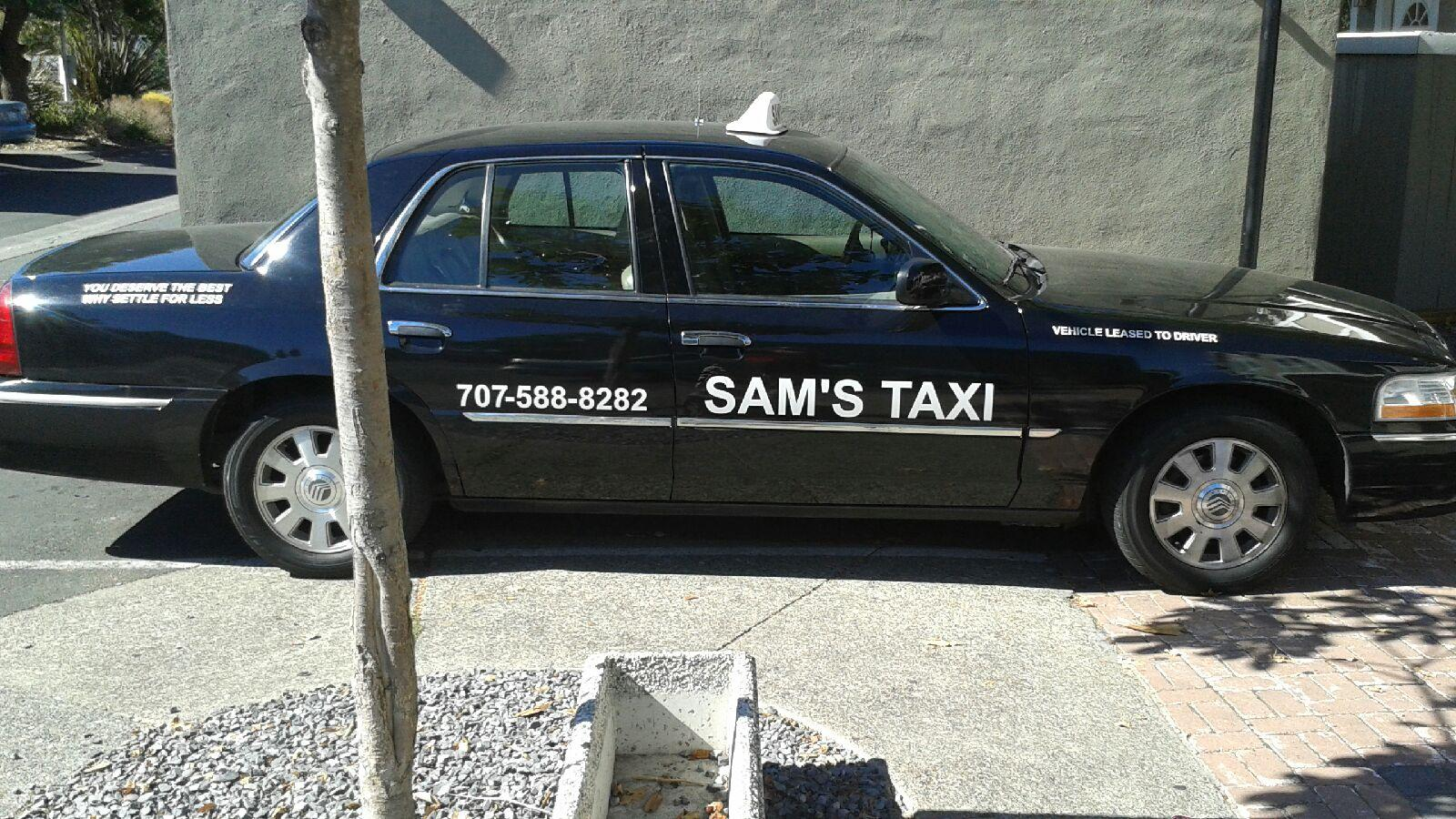 Sam's Taxi lettering